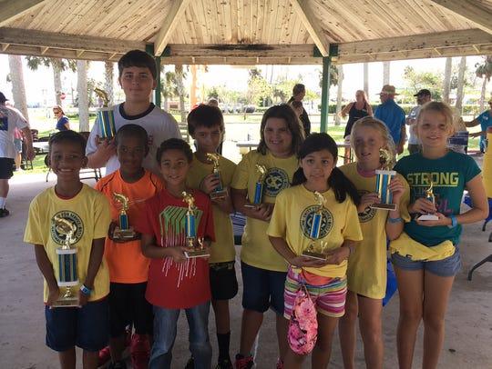 Receiving their trophies are Vanangel, Caleb, Jack,
