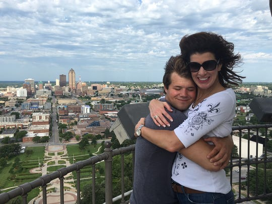 Sergei Neubauer and his mom, Mary, share a hug at the top of Iowa's Capitol in July 2016.