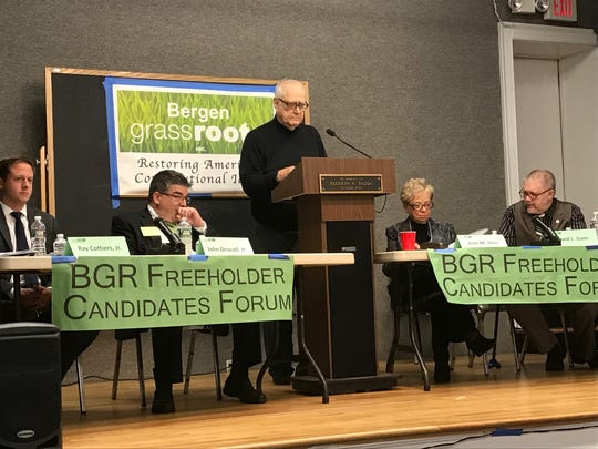 David Ganz, far right, at a recent candidates forum at the Teaneck Libary.
