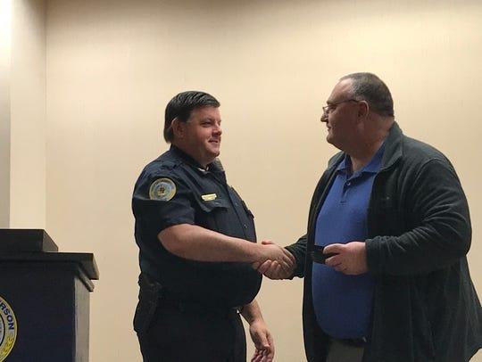 Chief Chip Stauffer thanks Lt. John Nevels for 28 years
