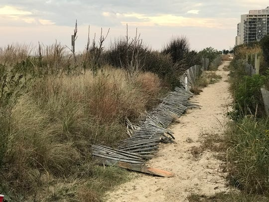 Broken fencing near 118th Street where Ocean City police say a man drove his SUV onto the dune until his vehicle stopped near 99th Street.