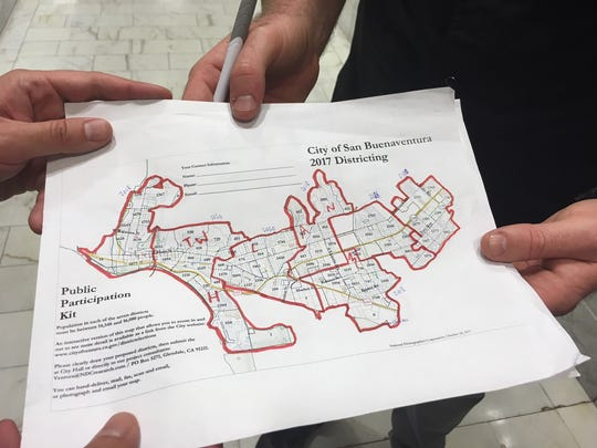 Lucas Zucker, of CAUSE, explains his proposal for seven new districts for the City Council.