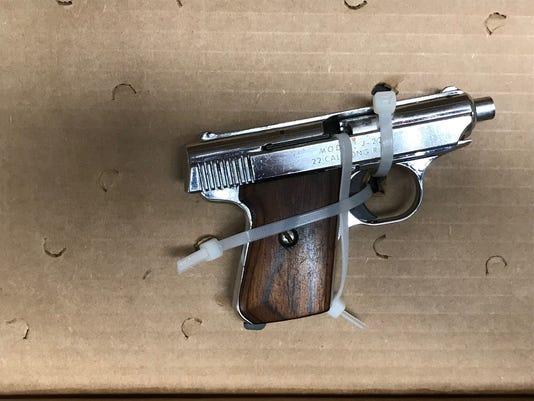 636461876074855787-pistol.jpg