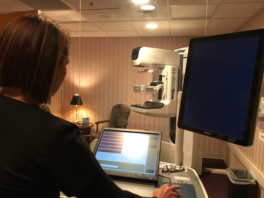 Wendy Mackey shows the new 3D mammography equipment at Methodist