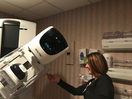 Wendy Mackey, a mammography tech at Methodist demonstrates new 3D equipment