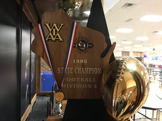 The 1995 state championship trophy sits in the New Berlin Eisenhower commons.
