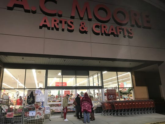 Shoppers line up outside of the A.C. Moore Arts & Crafts