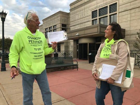 Mark and Shawn Kelderman seek signatures on a petition to reduce Oshkosh's fine for marijuana possession at the Oshkosh Public Library, Oct. 26.