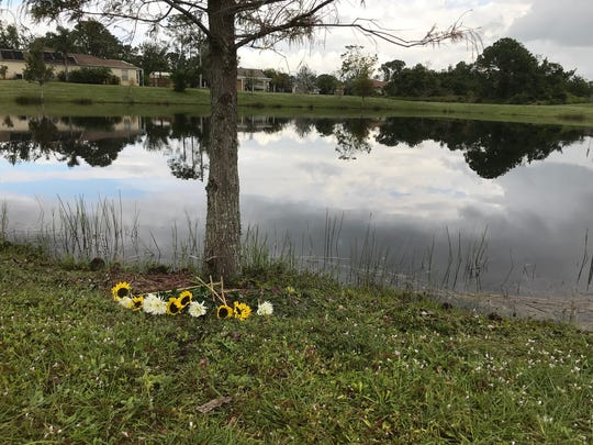 Flowers have been placed at the pond where Chelsea Noel's body was found Dec. 4, 2017.