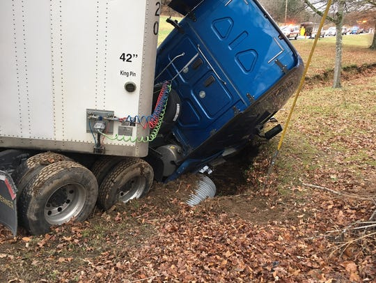 The truck crossed a lane line and landed in a creek,