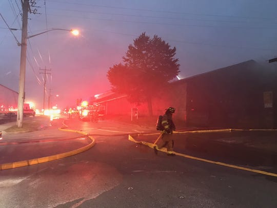 A firefighter is on the scene early Tuesday, Dec. 5,