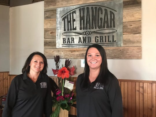 Lisa and Brook Marshall are new owners of the Charcoal Pit II, and have renamed the eatery The Hangar Bar and Grill.