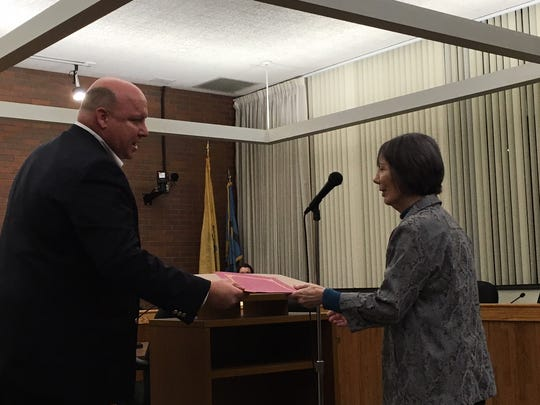 Mary Ceil Leedom receives a resolution from South Brunswick Deputy Mayor Charlie Carley.