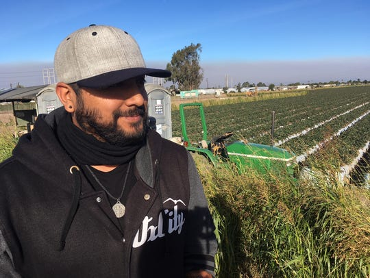 Raul Lopez visits a farm in Oxnard, where he distributed