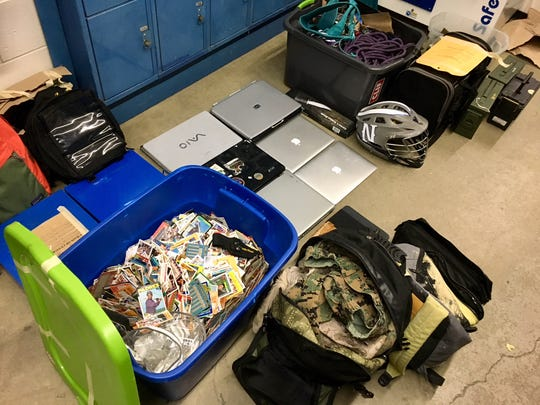 Detectives with the Washoe County Sheriff's Office released photos of stolen items they recovered during an investigation on Dec. 13, 2017. The items include scuba gear, baseball cards, ski and snowboarding equipment and laptops, among other items.