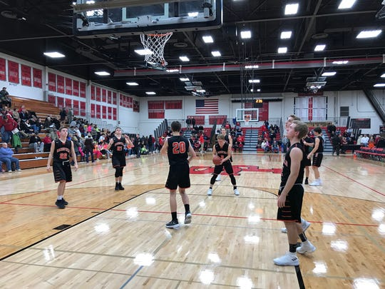 Marshfield players warm up before the start of the second half in their Wisconsin Valley Conference matchup with SPASH on Tuesday night.