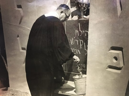 In June 1962, then-Rabbi Leonard B. Gewirtz spreads the first mortar on the cornerstone of Adas Kodesh Shel Emeth Synagogue on Washington Street Extension.
