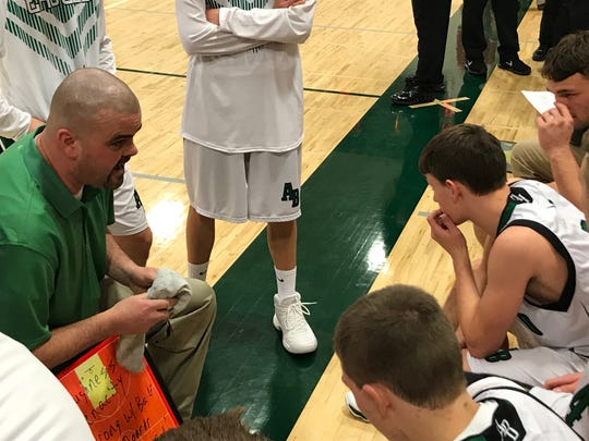 Almond-Bancroft coach Curt Lamb gives some final instructions prior to the start of the Central Wisconsin Conference-South showdown with Pacelli on Tuesday night.