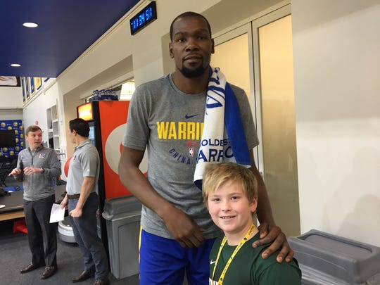 Golden State warriors forward Kevin Durant poses with Brennan Rexrode.