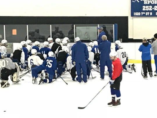 Sartell boys hockey coach Ryan Hacker talks to his
