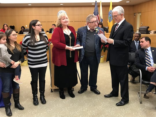 David Ganz, second from right, being sworn to his sixth