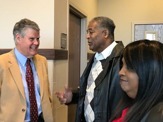 Henderson District Judge Charlie McCollom speaks with Samuel and Cassandra Happoldt during McCollom's retirement reception Jan. 4.