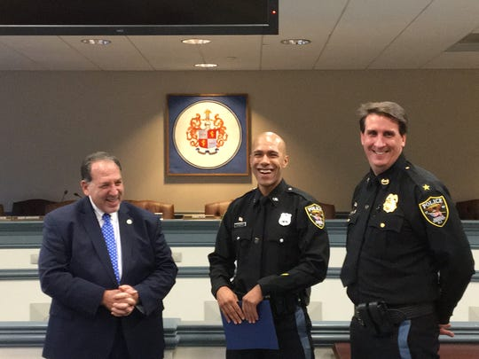 From left, Morris County Prosecutor Fredric M. Knapp, Morris Township Police Officer Diego Pinheiro, and Morris Township Police Chief Mark DiCarlo at a Jan. 12, 2018 commendation ceremony for their participation in the Hurricane Maria relief effort in Puerto Rico called Operation NJ Pride.