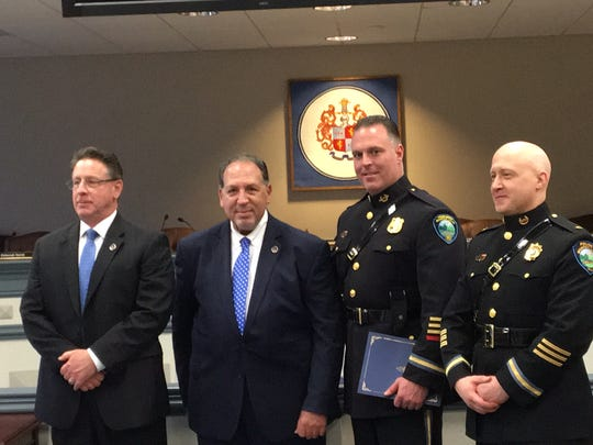 From left, Morris County Prosecutor's Office Chief of Investigations John Speirs, county Prosecutor Fredric M. Knapp, Mountain Lakes Police Corporal Samuel Trimble, and Mountain Lakes Police Chief Shawn Bennett at a commendation ceremony for local police who provided relief effort in Puerto Rico after Hurricane Maria.