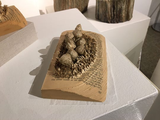 Artist Julie Dodd used a paperback as the 'soil' for her environmental sculpture of mushrooms.