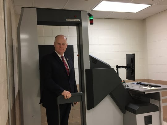 Morris County Sheriff James Gannon stands in the county jail's new ConPass full body security screening system
