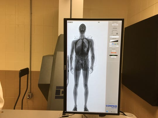 A new body imaging scanner at the Morris County jail takes an X-ray image of an inmate so potential weapons or drugs can be detected.