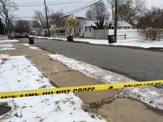 Police seen at a crime scene, a reported shooting.