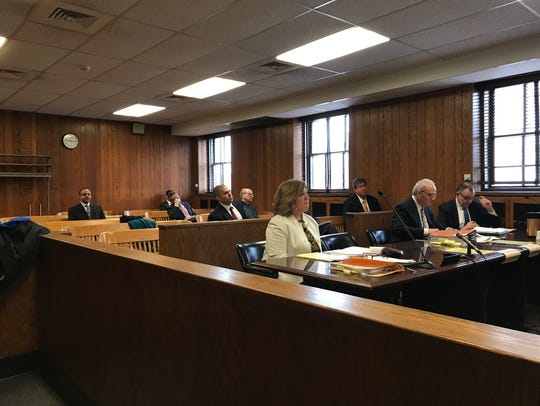 Attorneys wait to testify during a Jan. 19, 2018, hearing.