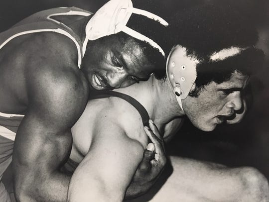 Jeff Parker (left), shown wrestling for LSU in 1981,