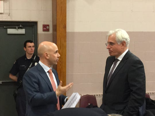 Left, Vision Real Estate Partners Ross Chomik and Michel Mane, president of Mane USA, chat Feb. 5, 2018 before a Morris Plains Planning Board meeting on Mane's proposal to site a fragrance plant off Tabor Road.