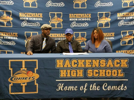 Hackensack HS WR/DB Justin Marshall signing his National