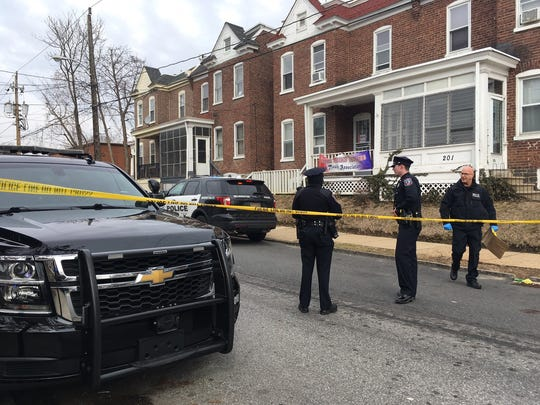 Multiple police vehicles were at the scene of a shooting in the 200 block of W. 23rd St.