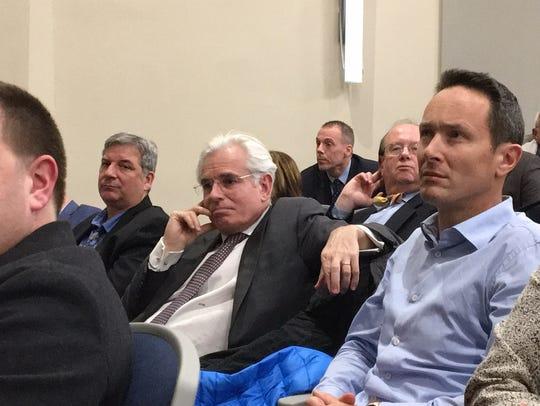 Michel Mane, center, listens Feb. 13, 2018 at a Morris