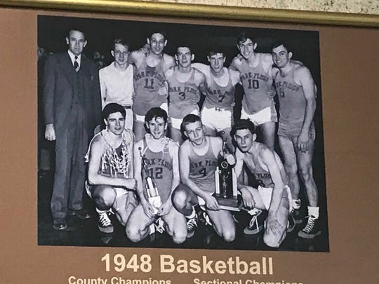 This photo of the 1948 Speedway team hangs in a school