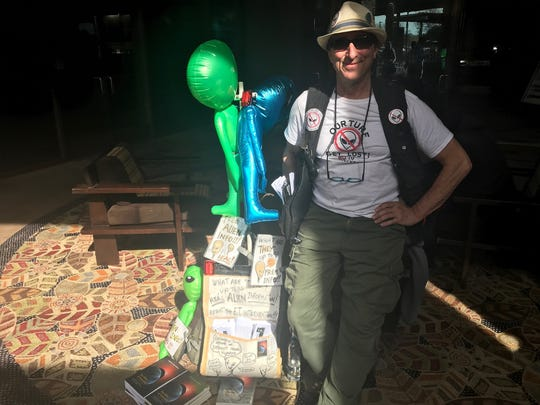 Justin Kohn hands out free information on aliens and