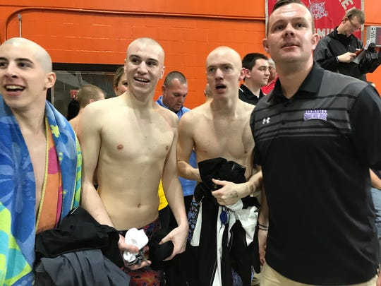 Lexington coach Brock Spurling with three members of district record-setting 200 medley relay team: Wilson Cannon, Cayman Eichler and Connor Miller.