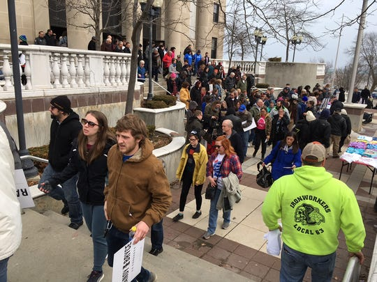 Hundreds of people packed Memorial Hall in Racine on