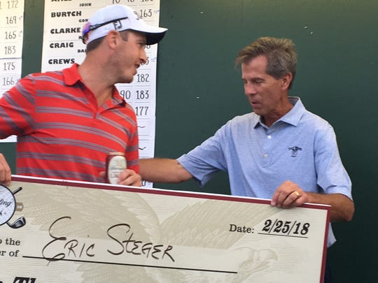 Tournament director Rich Lamb presents Yuengling Open winner Eric Steger  with a check for $10,000.