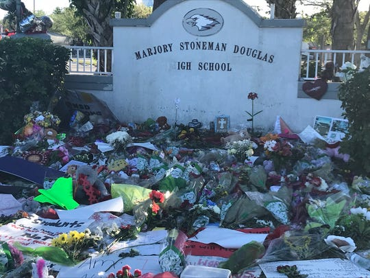 Flowers and messages greet visitors to Marjory Stoneman Douglas High School in Parkland.