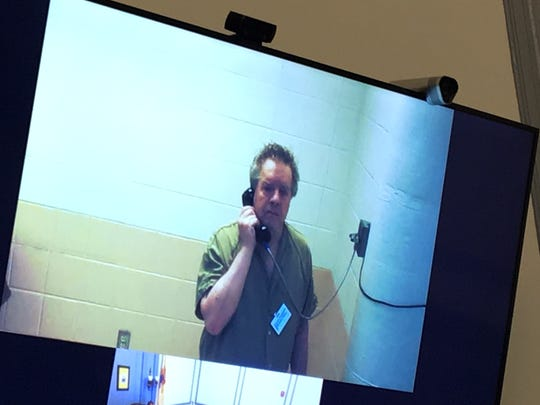 Lawrence Ball during a court appearance via a closed-circuit television link from the jail.