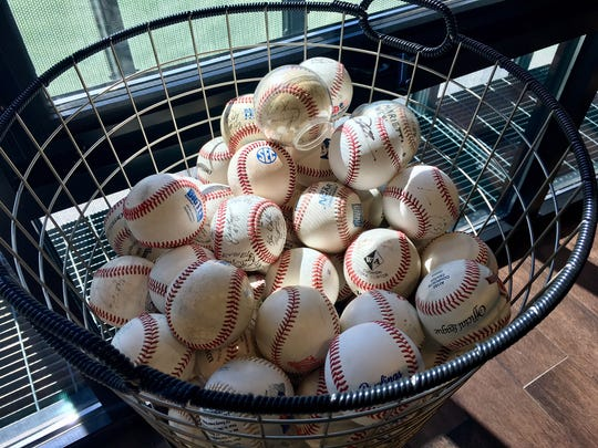 Basket of baseballs with famous autographs and sentimental value in Vanderbilt baseball coach Tim Corbin's office. They include balls autographed by Ted Williams, Roberto Clemente, Pete Rose, Carl Yastrzemski and others.