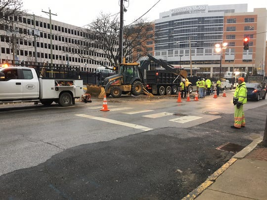 The Department of Public Works crew repair a wate rmain break that created a geyser at 10:30 a.m. Thursday.