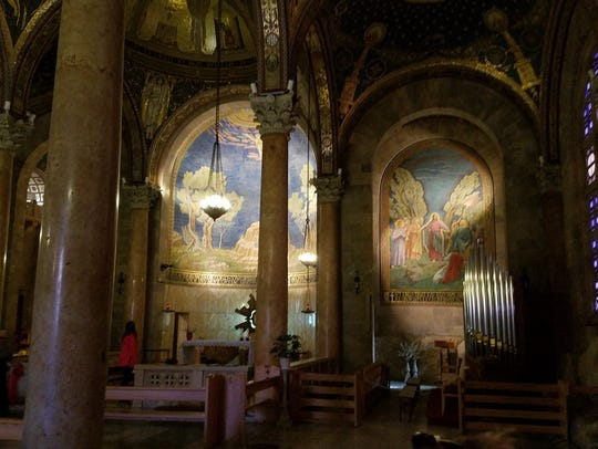 The interior front of the Church of All Nations in