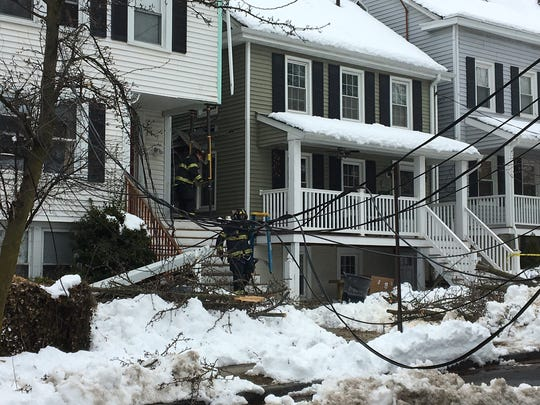 Phone wires hang down across James Street in Morristown after a truck pulled them down and damaged the house to which the wires were attached.