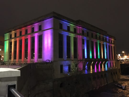 The Rochester Central Library was bathed in rainbow-colored lights in tribute to librarian Stephanie Squicciarini.
